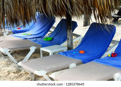 Children's toys on towels and loungers on the beach resort of Punta Cana, Dominican Republic - means that these places are occupied.