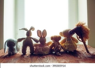 children's toys on wooden floor in front of the window