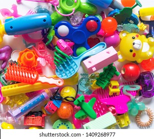 Children's toys are a lot of rainbow color. The collection of games baby. White background