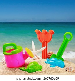 childrens toys in the sand on the beach. focus on toys