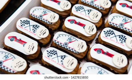 Children's treats and sweets at the birthday. French eclairs with a children's theme. 