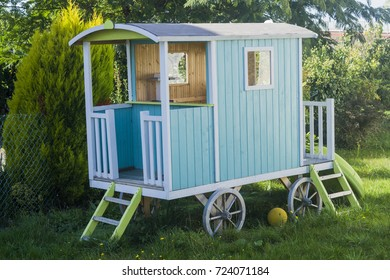 children's wooden house on wheels in the courtyard