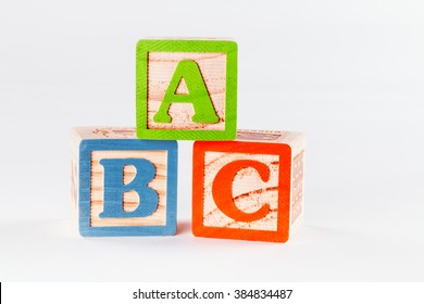 Children's wooden letter blocks showing a b and c