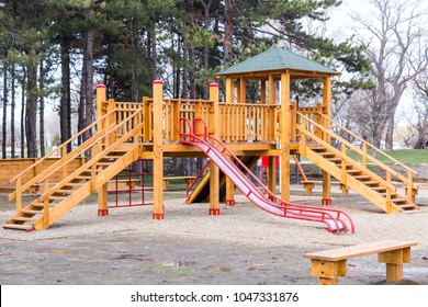 children's wooden playground with slides