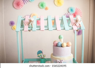 Children's wooden and textile toys. Toy trolley with ice cream and cupcakes. Handmade textile ice cream close-up and copy space. Brownies on a wooden trolley - Shutterstock ID 1565224195