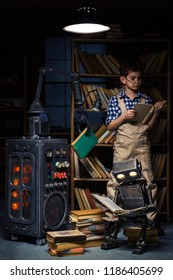 Child-robot and inventor-mechanic read books in a workshop late at night