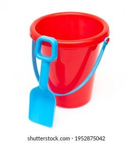 Child's beach pail and shovel on white