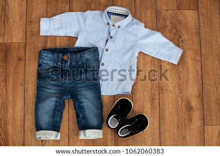 6aa5c665e99f Childs Classic Clothes On Wooden Background Stock Photo (Edit Now ...