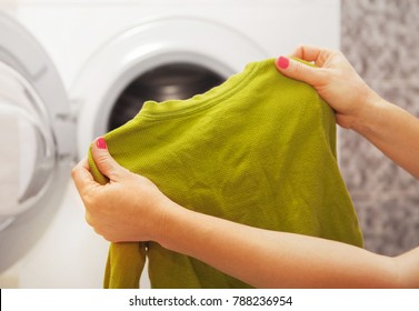 child's clothes, which is in the hands of a woman hoo is going to wash it