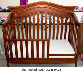 Child's crib for sale at suburban garage sale