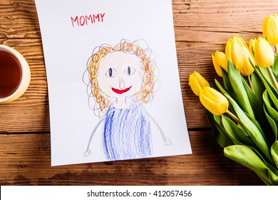 Childs drawing of her mother, yellow tulips, tea cup