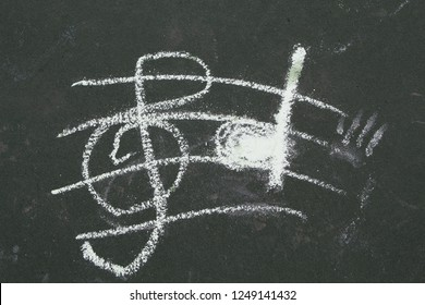 child's drawing of music notes on ground