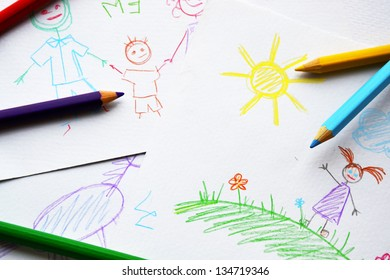 Child's drawings and colored pencils