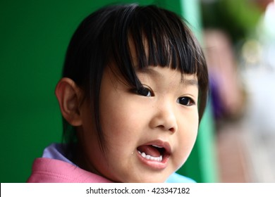A child's eyes Asian love. Portrait of a cute Asian child girl and looking aside in-Thailand.