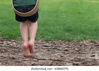 Child's feet on swing alone in the park