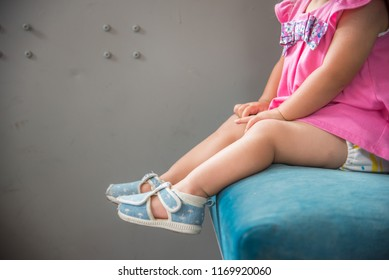 Child's foot sitting in a chair