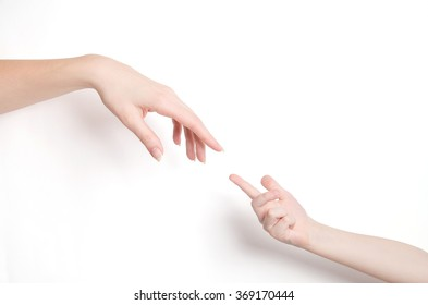 child's hand and adult's hand on white background