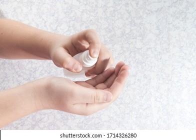 child's hand. antiseptic treatment. Coronavirus