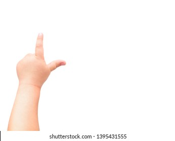 Child's hand on white background. The child points at something with his index finger. Flat lay, top view, copyspace.