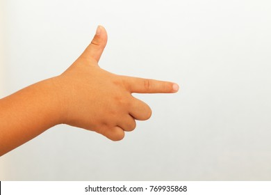 A child's hand pointing in the direction
