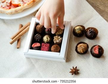 Child's hand take a sweet, closeup shot