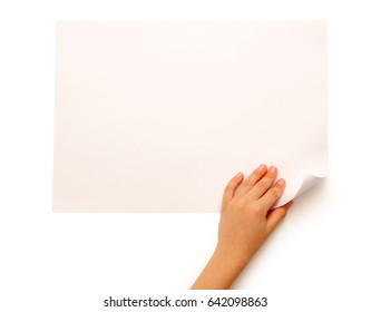 Child's hand turning over sheet of paper