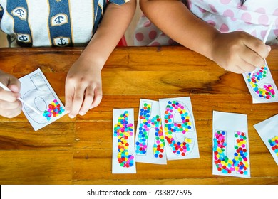 Child's hands doing artwork.