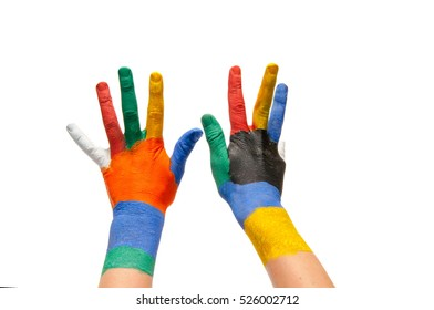 Child's hands painted with multicolored finger paints on white background