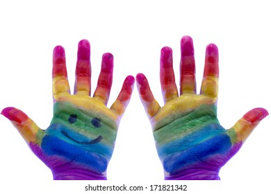 Child's hands painted watercolor on white background. Painted rainbow