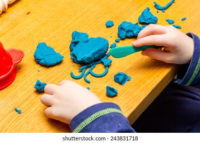 A Childs hands playing with Play Doh