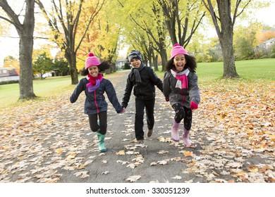 The Childs on the leaf season. The autumn season