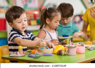 Childs are playing with play clay in classroom