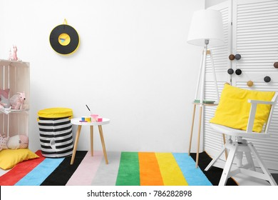 Child's room with drawing accessories on table