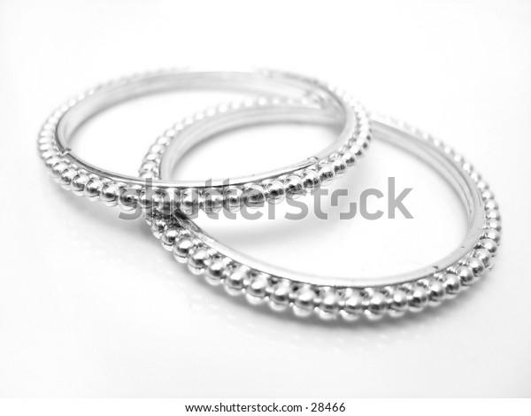 Child's toy bracelets against white background