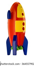 childs toy rocket on white background