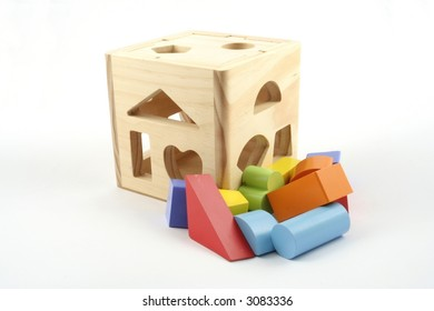 Childs toy shape sorter on white