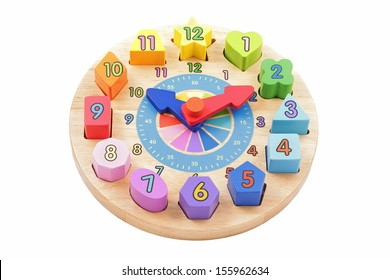 child's toy wooden clock with colourful number shapes on a white background