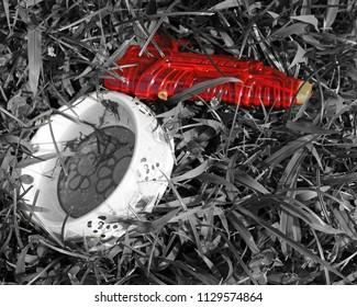 Child's water squirt gun left in the yard