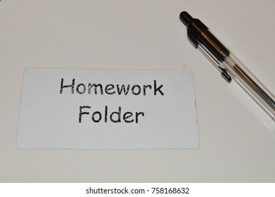 A child's white Homework Folder for school with an ink pen on top.