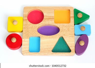 A child's wooden shape sorter jigsaw puzzle
