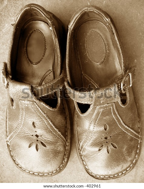 Child's worn, leather Mary-Janes.