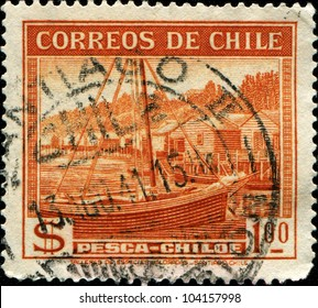 CHILE - CIRCA 1938: A stamp printed in Chile shows view of Pesca-Chiloe, circa 1938