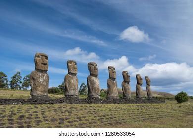 Chile, Easter Island aka Rapa Nui. Ahu Akivi, ceremonial platform with seven restored standing moai statues. Rapa Nui National Park, UNESCO. Row of moai.