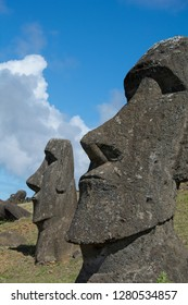 Chile, Easter Island aka Rapa Nui. Rapa Nui National Park, historic site of Rano Raraku 'the quarry'. Volcanic hillside where moai were carved. Detail of large moai faces.