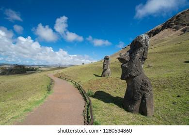 Chile, Easter Island aka Rapa Nui. Rapa Nui National Park, historic site of Rano Raraku 'the quarry'. Volcanic hillside where moai were carved. Stone moai heads with park walkways.