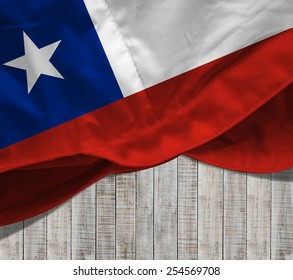 Chile flag and wood background