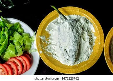 Chile relleno - poblano chili pepper coated in flour