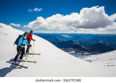 Chile September 13 2013. Two skiers enjoying the views from Villarrica  Volcano, Patagonia