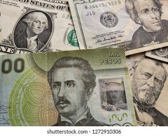 chilean banknote of 1000 pesos and american dollars bills