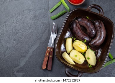 Chilean bloody sausages PRIETA with potatoes and sauce, Top View